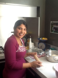 Rajia demonstrating rolling of parathas...a year with lovely friends.