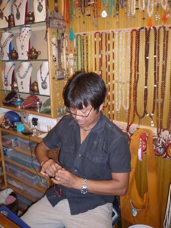 Choten busy at work at the Little Tibet Gift Centre...